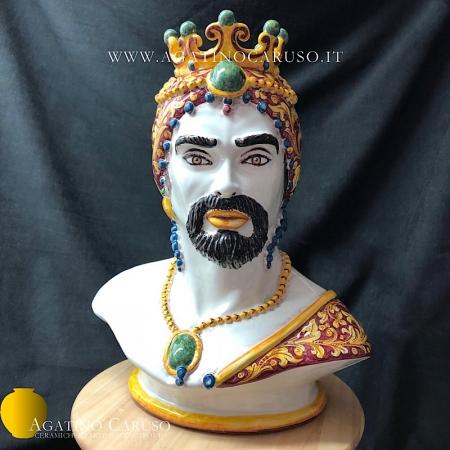 Testa antropomorfa modellata e decorato a mano con decoro ornato fondo bordeaux. Ceramiche d'arte di Caltagirone